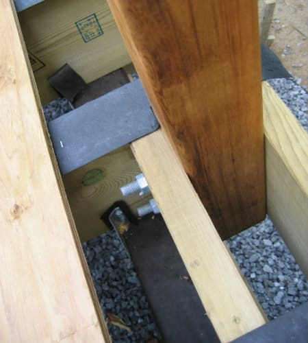 Rail posts attached to joists
