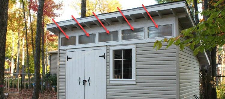 upper windows illuminate the shed