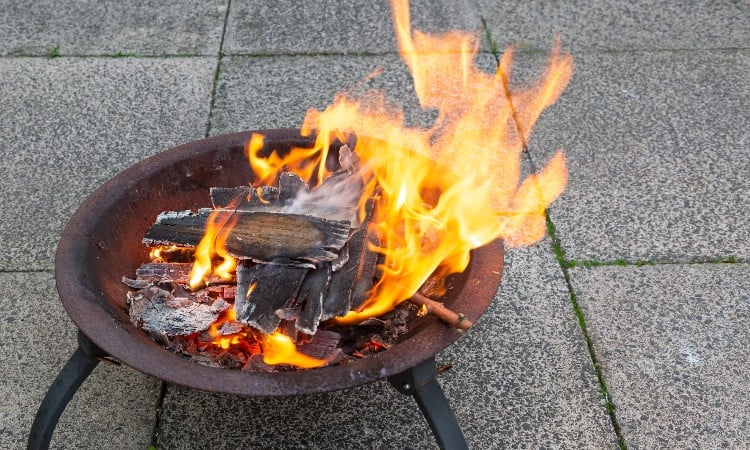 Protect concrete from fire pit