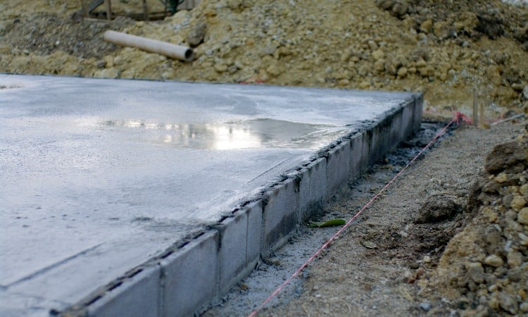 Rain on fresh concrete