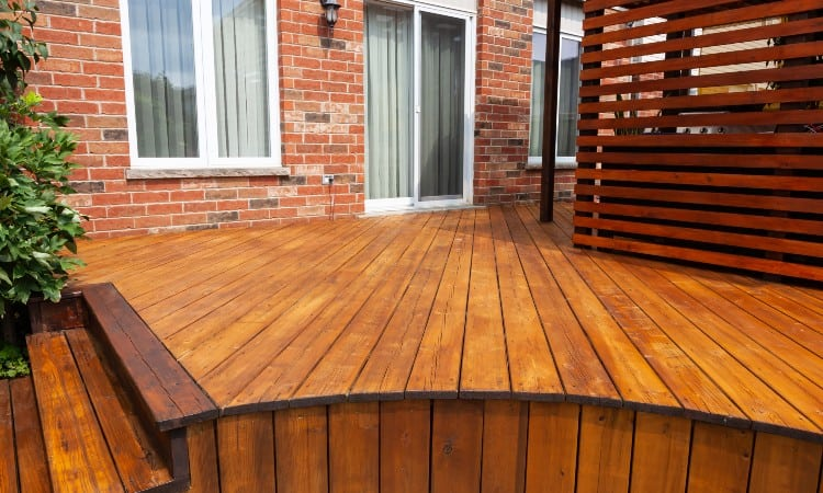 How long does deck stain take to dry