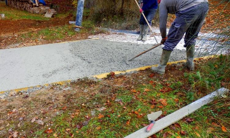 Pouring concrete over asphalt